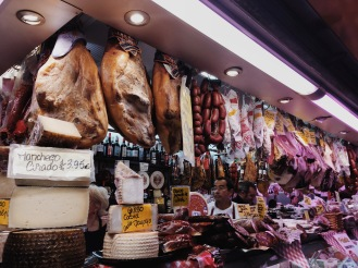 meat and cheese stand at the market